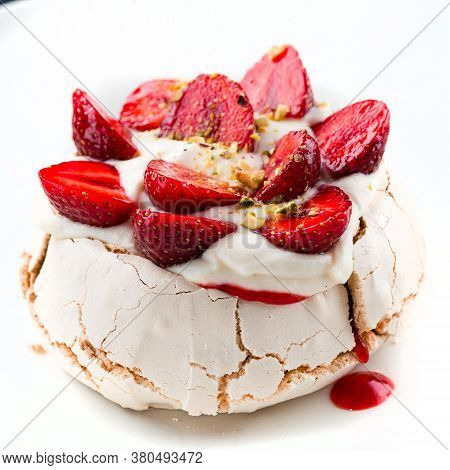 Rustic Pavlova Cake With Fresh Strawberries And Whipped Cream. Top View Sweet Dessert Meringue With