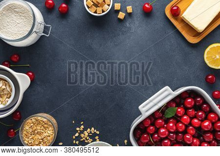 Frame Of Ingredients For Cooking Pie With Cherries Dark Background Top View