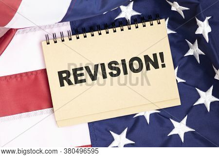 Word Writing Text Revision On The Background Of The American Flag. Business Concept.