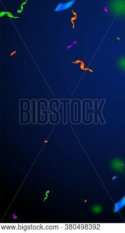 Streamers And Confetti. Festive Streamers Tinsel And Foil Ribbons. Confetti Vignette On Dark Blue Ba