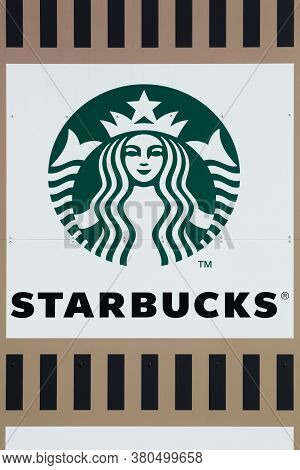 Macon, France - June 22, 2019: Starbucks Logo On A Wall. Starbucks Is An American Coffee Company And