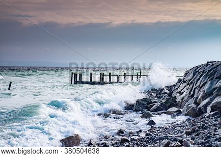 The Wild Storm Damaged Port Pier At Old Fishing Village Vitt. The Baltic Sea Coast Of Landkreis Vorp