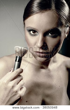 Woman Holds The Make-up Brush
