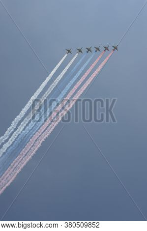 Moscow, Russia - June 20, 2020:a Group Of Su-25 Grach Attack Aircraft Smoke The Colors Of The Russia
