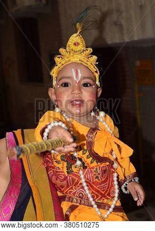 Delhi - India Aug 12th 2020 An Indian Child Dressed As Lord Krishna On Occasion Of Janmashtami Festi