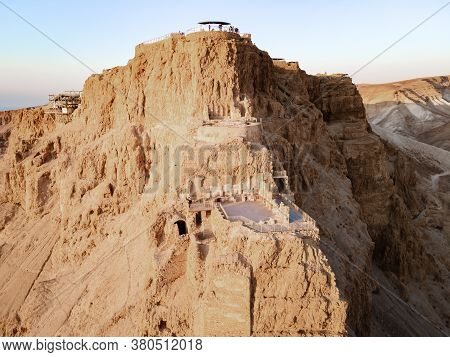 Aerial View Of The Ruins Of Massada Is A Fortress Built By Herod The Great On A Cliff-top Off The Co