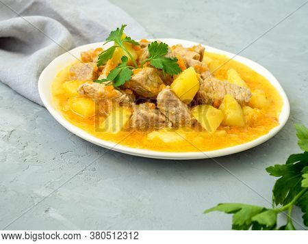 Concept Of Homemade Food. Meat Stew With Potatoes And Carrots. Pork Meat Stewed With Vegetables On A