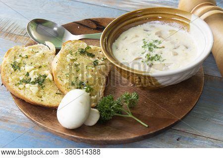 Garlic Bread And Cream Mushroom Soup On The Woodplate