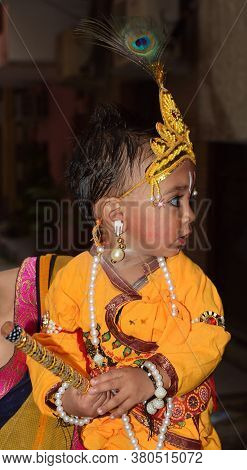 Delhi - India Aug 12th 2020 Side Angles Shot Of  Indian Child  Dressed As Lord Krishna On Occasion O