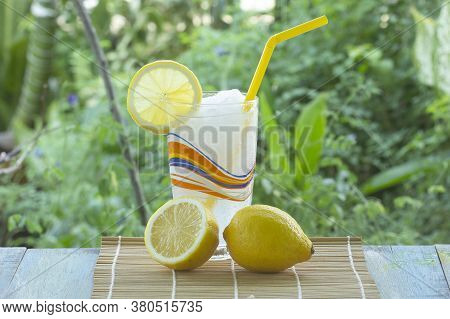 Lemon Fruit Smoothie On The Garden Background