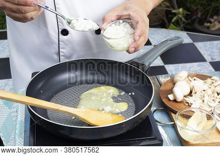 Chef Putting Minced Onion In The Pan Prepared For Cooking Mushroom Cream Soup / Cooking Mushroom Cre