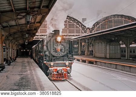 Vintage Steam Locomotive At The Railway Station.