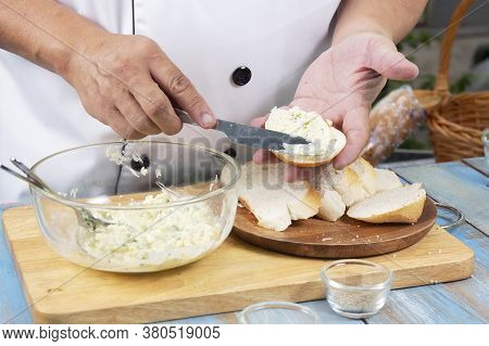 Chef Spread Garlic Butter On Slice Bread / Cooking Garlic Bread Concept
