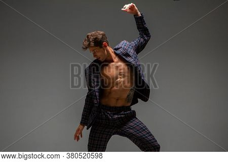 Young Guy Dancer In Suit Dancing Modern Expressive Dance In Studio. Dance School Poster. Dance Lesso