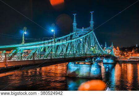 Night View Of The Illuminated Liberty Bridge In Budapest.