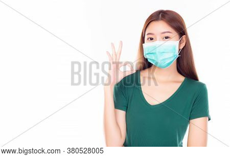 Young Asian Woman Wear Medical Mask For Protection Versus Viruses And Infection Or Protection Of Air