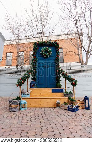 Entrance Christmas Composition From A Traditional Christmas Wreath, Arch Of Fir Branches And Railing