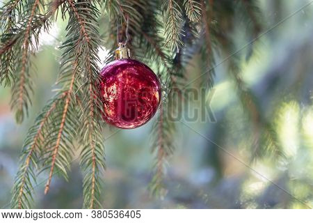 Christmas Decoration, Bauble Ball Hanging On Fir Tree Over Abstract Bokeh Background, Selective Focu