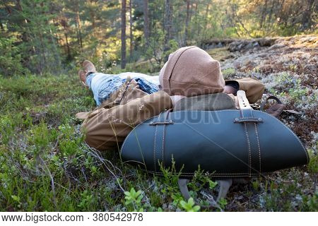 Man Lies On The Grass, Resting At The Forest Relaxing