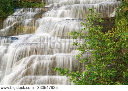 Close Up On Cascade Waterfall On The Cliff