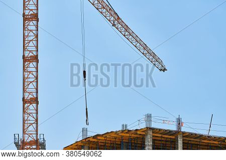 Construction Crane Working On Building Complex. Election New Shopping Center In City Downtown. Hardw