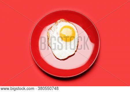 Dish With Fried Egg And Raw Yolk.