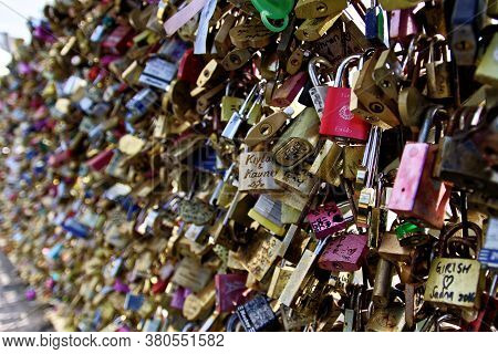 Paris, France, April 2, 2017:close Up And Selective Focus Of Many Love Locks, Padlocks With Names An