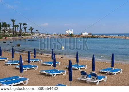 Protaras, Cyprus - August 2 2020: Idyllic Beach With Golden Sand And Turquoise Water With Tourists D