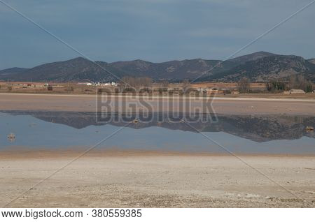 Mountains Reflected In A Lagoon In The Gallocanta Lagoon Natural Reserve.