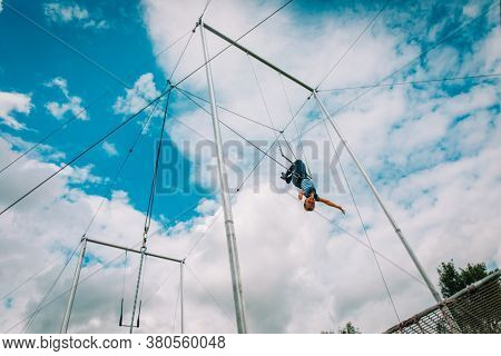 Kid Having Swing On A High Flying Trapeze, Boy Learning Acrobatic