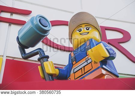Billund, Denmark, July 2018: Big Plastic Lego Man On The Roof Of A Gift Shop In Legoland In Denmark