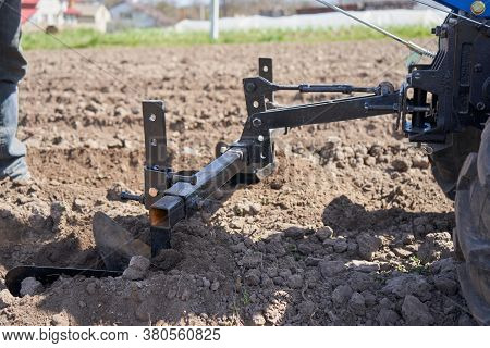 Two Plows Plow The Ground, Man Plows The Field With A Plow On The Ground