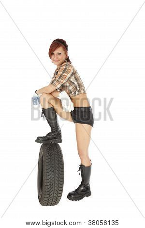 Woman On A Car Tyre