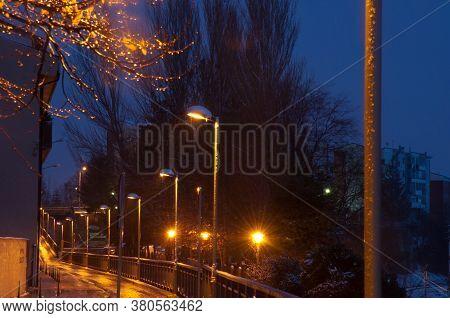 Illuminated Street Lamps On A Street In Sabinanigo At Nightfall.