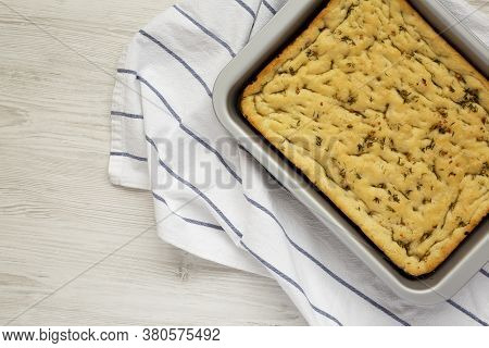Home-baked Rosemary Garlic Focaccia Bread On A White Wooden Background, Overhead View. Flat Lay, Top