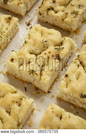 Home-baked Rosemary Garlic Focaccia Bread, Low Angle View. Close-up.