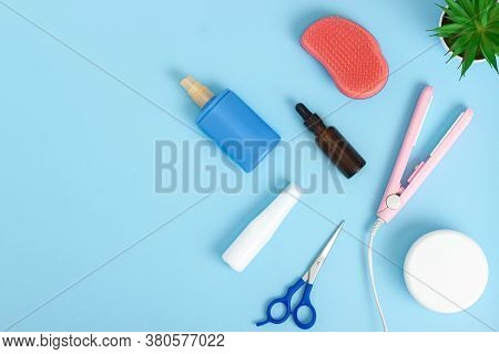 Hairdresser Tools On Blue Background With Copy Space. Professional Hair Dresser Tools