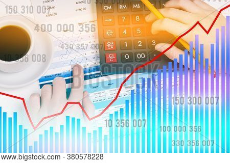 Calculator And Hands With A Pencil. A Person Calculates On A Calculator And Analyzes The Data. Finan