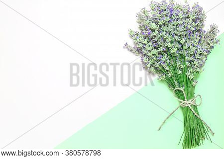 Lavender Flower Bouquet On Lilac Background. Purple Flower On Table. Top View, Flat Lay Design