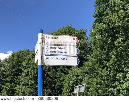Almere, The Netherlands - June 20, 2020: Dutch Anwb Bicycle Direction Signs.