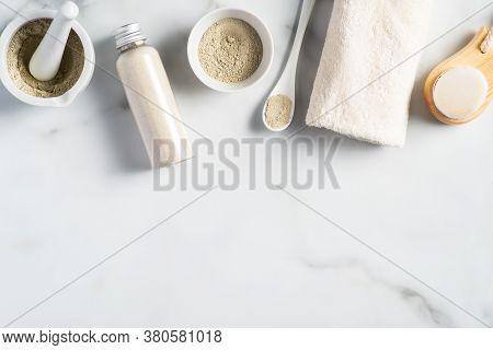 Ayurvedic Face Pack/mask Using Gram Flour/besan, Haldi Ubtan Placed In Bowls , Scrub And White Towel