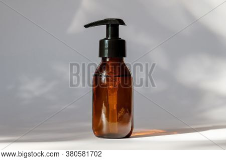 Brown Amber Glass Bottle With Lotion Pump Dispenser. Cosmetic Container For Shampoo, Essential Oil,