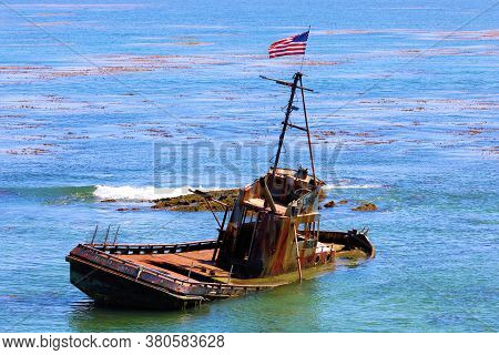 August 3, 2020 In Cayucos, Ca:  Sunken Fishing Vessel That Hasn\'t Fully Sunk Because Of The Shallow