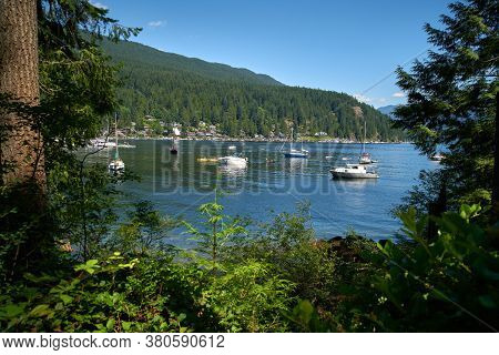 Deep Cove Summer Sports Bc. Kayaks And Canoes On The Water In Deep Cove, British Columbia.