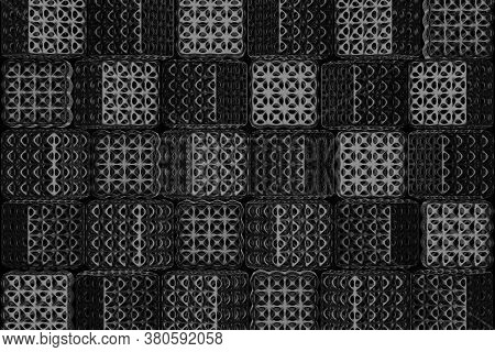 Shiny Black Square And Holes Penetrating From Each Side Floating In The Dark. The Pattern Of Many Bl