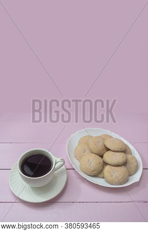 Cup Of Americano Coffee And Homemade Cookies On Pink Background. Copy Space. The Concept Of Romance,