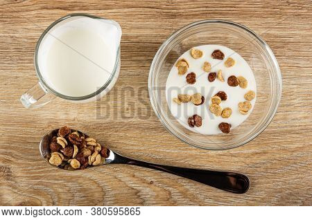 Transparent Pitcher With Yogurt, Cereal Grains Breakfast With Chocolate And Caramel In Glass Bowl Wi