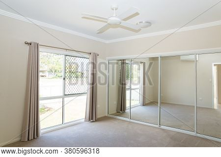 Bedroom In New Contemporary House With Sliding Glass Mirror Doors And Sliding Glass Windows With Sec