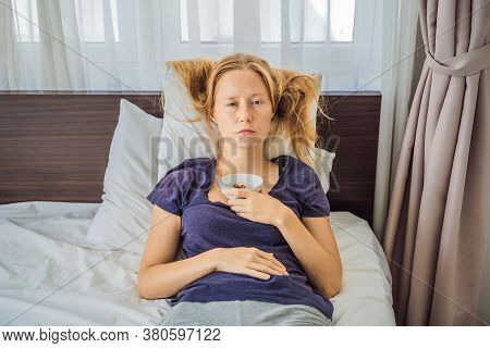 Extremly Tired Young Woman Lying On The Bed, Home Alone. Self-isolation At Home, Quarantine Due To P