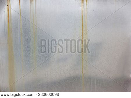 Metal Polished Surface With Rust Streaks. Textured Backdrop
